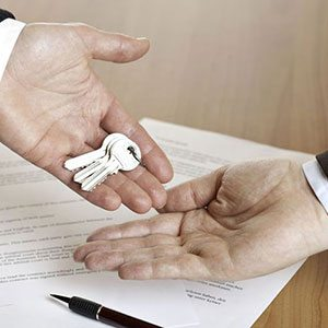 hands exchanging keys - how to sell any house - Mark King Properties